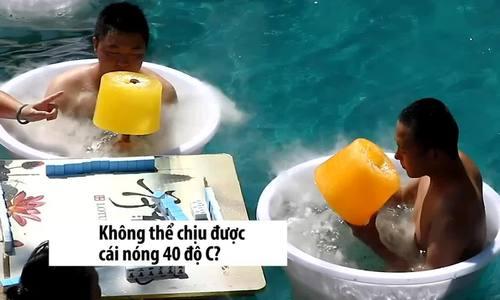 Khách Trung Quốc tắm nước đá, ăn kem khổng lồ tránh nóng - ảnh 1