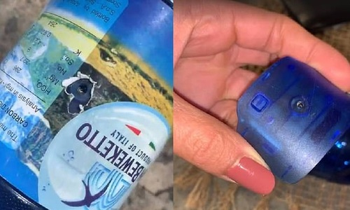 Khách nữ phát hiện camera quay lén mình trên bãi biển