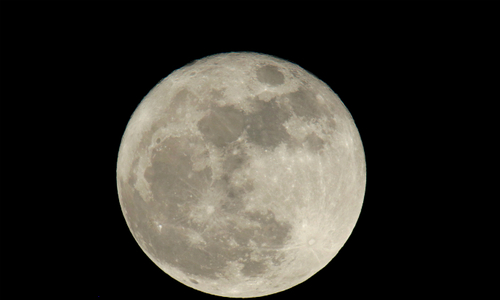 Supermoon shines from east to west