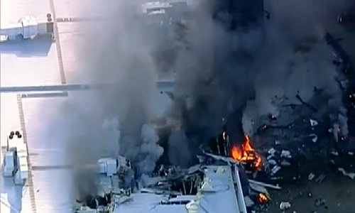 Five die as light plane crashes into mall in Australia