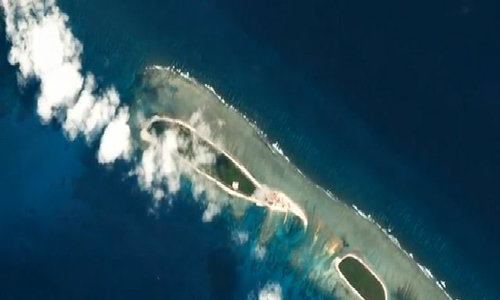 China begins new work on disputed South China Sea islands