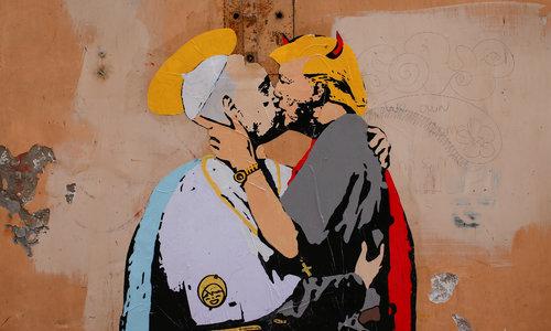 Mural near Vatican shows Pope Francis kissing Trump