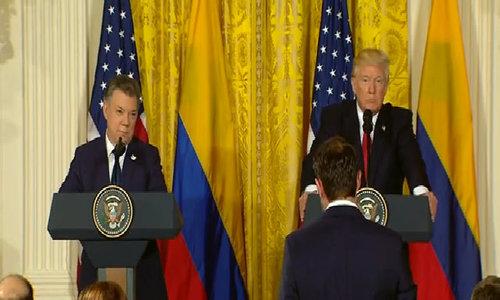 Trump defends Comey firing, denies asking FBI chief to end Flynn probe
