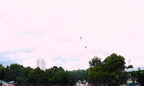 Saigonese flying kites...from a canoe