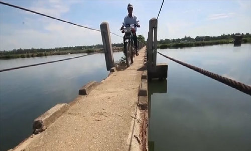 Crossing the 'fateful bridge' in central Vietnam