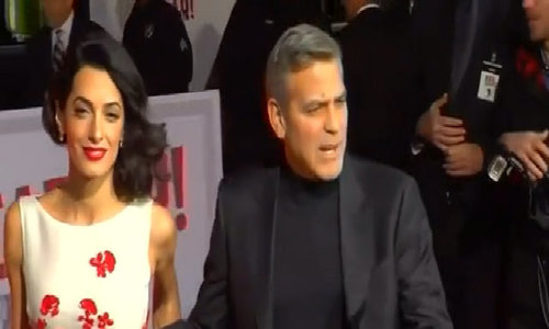 Clooney vows to sue French magazine over twins' photos