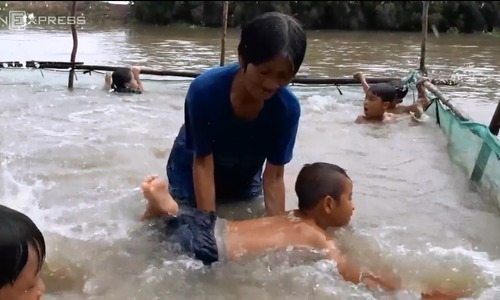 No pool, no problem: Mekong grandma spends 15 years teaching kids to swim for free