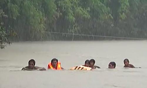 Schoolkids take on raging river to get to school in northern Vietnam
