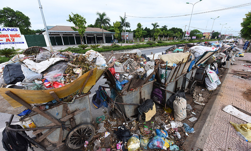 Tons of putrid trash fill the streets on outskirts of Hanoi