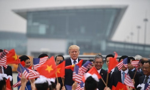 Wrap-up: Trump's arrival in Vietnam met with excitement and doubt