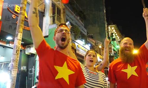 Tourists join the party as Vietnamese football fans celebrate dramatic victory over Qatar