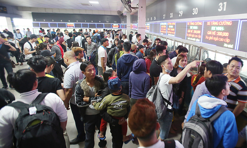 Travelers in Hanoi face long wait to get home for double holiday break