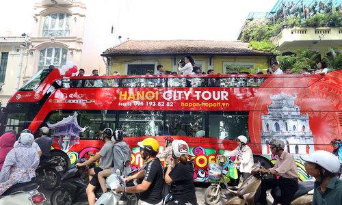 Double-decker bus hits Hanoi streets