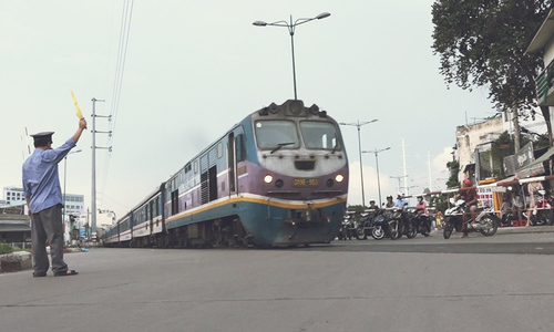 On the beaten track: Railway guards in Vietnam