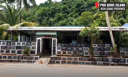 This house in Phu Quoc has a fence made entirely of 400 old television sets