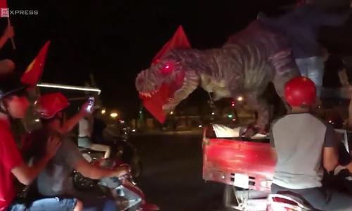 Dedicated football fans make dinosaur to support national football team