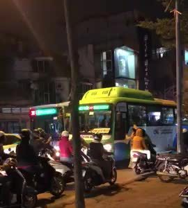Motorcycles block a bus