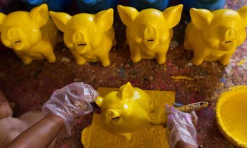 Take a nostalgic visit to a craft village that makes piggy banks