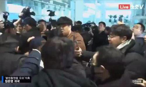 Jung Joon Young bị vây kín, nắm tóc khi vừa về đến Hàn Quốc