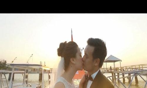 Hoa hậu Thảo Nhi 'khoá môi' chồng trong ảnh cưới