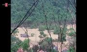 Dân Bản Sen thu gom tài sản sau trận ngập sâu 20 m