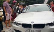 Chủ xe đập vỡ kính xe sang BMW giải cứu bé gái